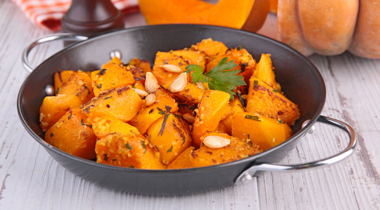 Cooked and diced pumpkin in a pan