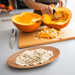 Cleaning a pumpkin for cooking