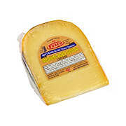 Frico Medium Aged Yellow Waxed Gouda Cheese, sold by the