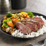 Grilled Sirloins In Spicy Beer Marinade
